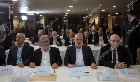 Palestinian top leader of the Hamas movement, Sheikh Ismail Haniyeh (C-R), and the top leader of the Islamic Jihad, Zaid Nakhaleh (C-L), and their accompanying delegation, with other Palestinian leaders attend the opening session of the meeting of the general secretaries of the Palestinian national action factions, with the Palestinian president Mahmoud Abbass who speaks via video conference from the West Bank in occupied Palestine, at the invitation of the Embassy of the State of Palestine, in the hall of the martyr President Yasser Arafat, at the embassy in Beirut, Lebanon 03 September 2020.