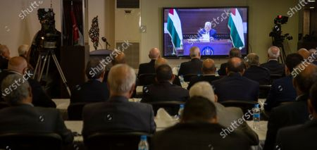 Palestinian President Mahmoud Abbass speaks on a screen via zoom conference from the West Bank in occupied Palestine, with the Palestinian factions during the opening session of the meeting of the general secretaries of the Palestinian national action factions, at the invitation of the Embassy of the State of Palestine, in the hall of the martyr President Yasser Arafat, at the embassy in Beirut, Lebanon 03 September 2020.