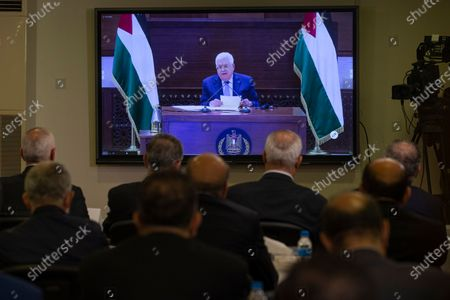 Stock Photo of Palestinian President Mahmoud Abbass speaks on a screen via zoom conference from the West Bank in occupied Palestine, with the Palestinian factions during the opening session of the meeting of the general secretaries of the Palestinian national action factions, at the invitation of the Embassy of the State of Palestine, in the hall of the martyr President Yasser Arafat, at the embassy in Beirut, Lebanon 03 September 2020.