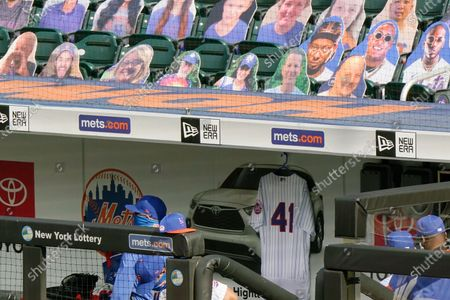 Tom Seaver's No. 41 jersey hangs in the New York Mets dugout before the start of a baseball game against the New York Yankees at Citi Field, in New York. Seaver died on Aug. 31