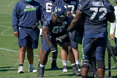 Seattle Seahawks guard Damien Lewis (68) lines up for a practice drill during NFL football training camp, in Renton, Wash