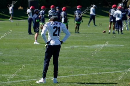 Seattle Seahawks cornerback Tre Flowers stands on the field during NFL football training camp, in Renton, Wash