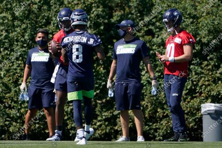Seattle Seahawks wide receiver Paul Richardson (8) prepares to catch a ball in a practice drill during NFL football training camp, in Renton, Wash
