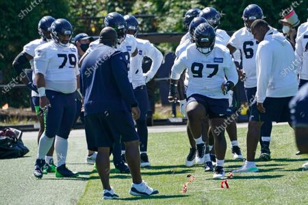 Seattle Seahawks defensive tackle Poona Ford (97) runs an agility drill during NFL football training camp, in Renton, Wash