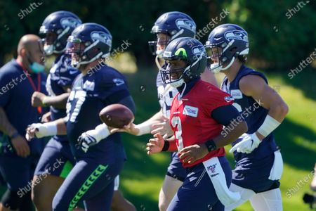 Seattle Seahawks quarterback Russell Wilson (3) warms up during NFL football training camp, in Renton, Wash