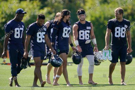 Seattle Seahawks' Stephen Sullivan, Tyler Mabry, Luke Willson (82), Jacob Hollister and Greg Olsen, from left, walk off the field on the last day of NFL football training camp for the team, in Renton, Wash