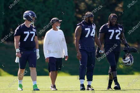 Seattle Seahawks guard Ethan Pocic (77) and offensive tackles Cedric Ogbuehi (74) and Brandon Shell (72) walk off the field following the last day of NFL football training camp for the team, in Renton, Wash