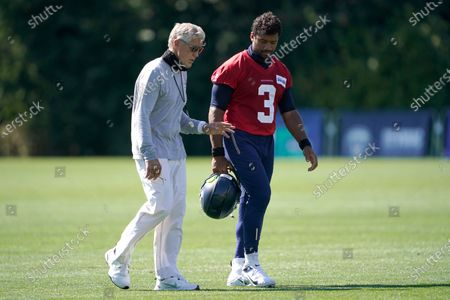 Seattle Seahawks quarterback Russell Wilson (3) walks with head coach Pete Carroll after the last day of NFL football training camp, in Renton, Wash