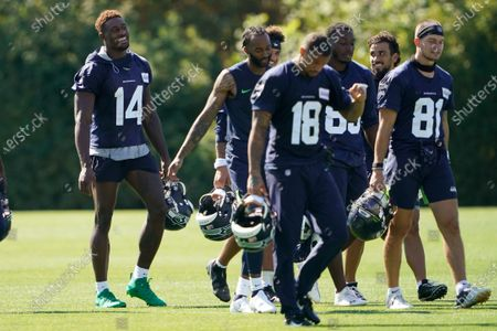 Stock Photo of Seattle Seahawks wide receiver DK Metcalf (14) laughs as he walks with teammates on the last day of NFL football training camp for the team, in Renton, Wash