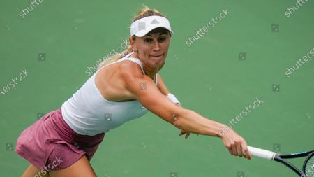 Olga Govortsova, of Belarus, returns a shot to Sloane Stephens, of the United States, during the second round of the US Open tennis championships, in New York
