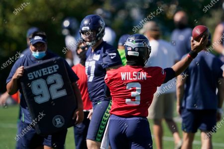 Seattle Seahawks quarterback Russell Wilson (3) passes during NFL football training camp, in Renton, Wash