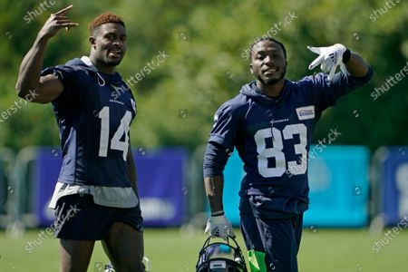 Stock Picture of Seattle Seahawks wide receivers DK Metcalf (14), and David Moore (83) react to seeing a camera as they leave the field on the last day of NFL football training camp, in Renton, Wash