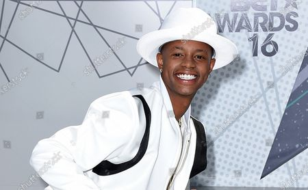 """Stock Picture of Silento arrives at the BET Awards on June 26, 2016, in Los Angeles. The rapper, known for """"Watch Me (Whip/Nae Nae)"""" and whose legal name is Richard Lamar Hawk, was charged, with trying to hit two people with a hatchet in their home. Hawk is charged with assault with a deadly weapon and is being held in jail on $105,000 jail, the Los Angeles County district attorney's office said"""