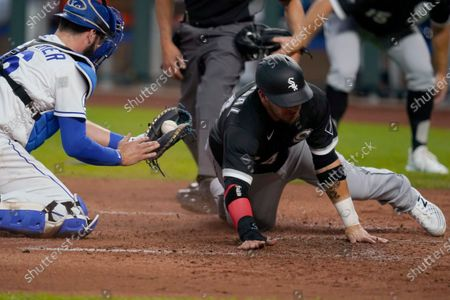 Kansas City Royals catcher Cam Gallagher (36) shows the ball after tagging out Chicago White Sox's Yasmani Grandal, right, during the second inning of a baseball game at Kauffman Stadium in Kansas City, Mo