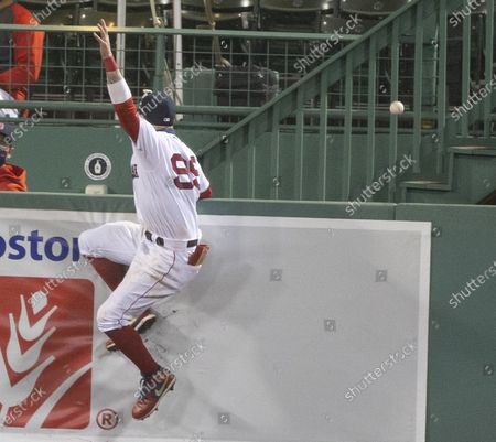 Stock Picture of Boston Red Sox center fielder Alex Verdugo is unable to stop the ball for a home run by Toronto Blue Jays designated hitter Teoscar Hernandez during the tenth inning of the MLB baseball game between the the Toronto Blue Jays and Boston Red Sox at Fenway Park in Boston, Massachusetts, USA, 03 September 2020.