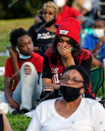 Woman reacts during a Chadwick Boseman Tribute, in Anderson, S.C