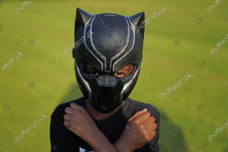 Black Panthers fan, Keyon Griffin, 7, of South Carolina, poses for a portrait during a Chadwick Boseman Tribute, in Anderson, S.C