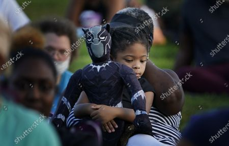 Khloe Murray, 5, of South Carolina, holds her Black Panther doll during a Chadwick Boseman Tribute, in Anderson, S.C