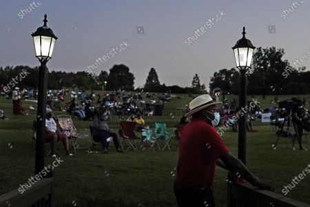 Man watches the Black Panther movie during a Chadwick Boseman Tribute, in Anderson, S.C