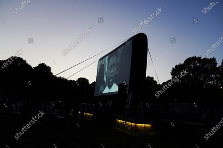 Video of Chadwick Boseman during a graduation speech is played on screen during a tribute to Boseman's life, in Anderson, S.C