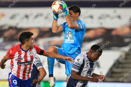 Stock Image of Pachuca goalkeeper Oscar Ustari (C) jumps for the ball with his teammate Oscar Murillo (R) and Nicolas Ibanez of San Luis (L) during a Mexican soccer 2020 Guardianes tournament match between Pachuca and San Luis at the Hidalgo stadium in Pachuca, Mexico, 03 September 2020.