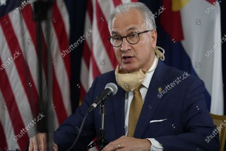 Mark Kennedy, president of the University of Colorado system, makes a point during a news conference about the state's efforts against the the new coronavirus, in Denver