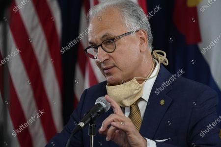 Stock Picture of Mark Kennedy, president of the University of Colorado system, makes a point during a news conference about the state's efforts against the the new coronavirus, in Denver