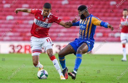 Ashley Fletcher of Middlesbrough and Ethan Ebanks-Landell of Shrewsbury Town