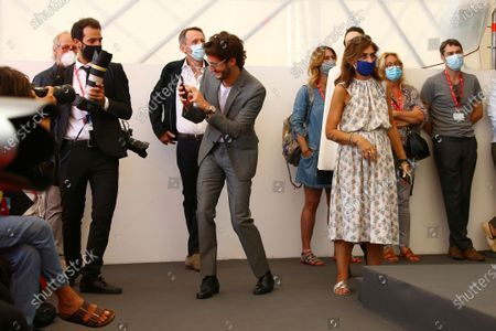Benoit Magimel photographs the photographers at the photo call for the film 'Amants (Lovers)' during the 77th edition of the Venice Film Festival in Venice, Italy