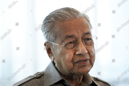 Former Prime Minister Mahathir Mohamad speaks during an interview with The Associated Press in Kuala Lumpur, . Mahathir said Friday that Malaysia's governing coalition isn't likely to call for early general elections due to political infighting and foresee his new ethnic Malay party to play the role of kingmaker in the next polls