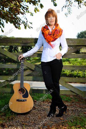 Kiki Dee in Hertfordshire, (her guitar is her baby)