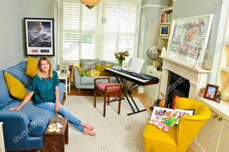 Claire Goose 'My Haven'-Living Room of her West London Home 25.6.2019.  1.Childrens Book 'Goodnight Moon' 1st Shoes and Photo book 2.Royal TV Society Award 3. Piano 4. Wildlife Picture/Map of the World 5. Shells from Norfolk 6.Wedding Photo  7.Holly Aird from Waking The Dead bought me this Neckless for my 30th birthday 8.This photo is in my office-just reminds me of the fun we had on set 9.Buzz Aldrin signed Moon Photo  10.Books for love of cooking-my main thing is baking cakes and puddings. My gran was a great baker and so is my mum 11.CG in Africa Photo & native figures (elder brother, Duncan, an entrepreneur who started up the One Drinks company (best known for One Water), which donates its profit to clean water projects in Africa.