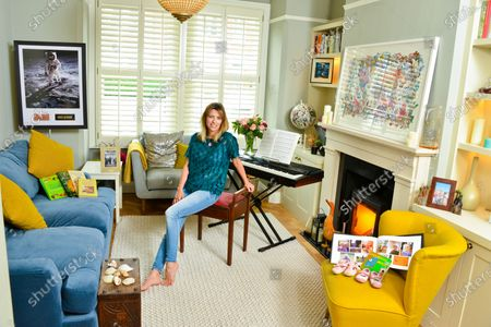 Stock Picture of Claire Goose 'My Haven'-Living Room of her West London Home 25.6.2019.  1.Childrens Book 'Goodnight Moon' 1st Shoes and Photo book 2.Royal TV Society Award 3. Piano 4. Wildlife Picture/Map of the World 5. Shells from Norfolk 6.Wedding Photo  7.Holly Aird from Waking The Dead bought me this Neckless for my 30th birthday 8.This photo is in my office-just reminds me of the fun we had on set 9.Buzz Aldrin signed Moon Photo  10.Books for love of cooking-my main thing is baking cakes and puddings. My gran was a great baker and so is my mum 11.CG in Africa Photo & native figures (elder brother, Duncan, an entrepreneur who started up the One Drinks company (best known for One Water), which donates its profit to clean water projects in Africa.