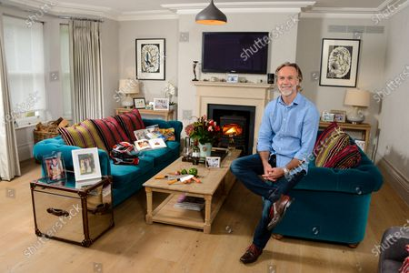 Marcus Wareing 'My Haven' - Living Room of his SW London Home  1. Photo of our kids when younger - couple to choose from(wife Jane, 3 Kids, Jake,Archie and Jessie) 2.Marcus & Jane's Wedding Photo with his parents 3.Boxing trophy from the Rumble in the Jungle bout in 2012 4.Cook books including one from the Savoy (open)Old family one & Marcus's  5.Knives, Board and onions from Melfort - links to countryside, kitchen garden, new book, father as a fruit and veg merchant and cooking 6.Watch from his 30th bday - given to him by Gordon Ramsay photo.  7.Trophy from Catey  8.Zalto Wine glasses and wine - hobby! 9.Motor Bike Helmet 10.Photo of Marcus aged 5 yrs