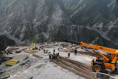 Indian laborers work at an under construction first cable-stayed bridge to connect Udampur- Srinagar- Baramulla- Rail link project (USBRL) of Indian Railways in Reasi district of Jammu and Kashmir,  some 80 KM from Jammu, India, 04 September 2020. Anji Bridge has a single main pylon of height 193m from the top of foundation, standing at a height of 331 metres above the river bed. The total length of Bridge is 725.50m consisting of Main Bridge having the length of 473.25 metres and  Anji bridge is being constructed between Reasi district of Union territory of Jammu and Kashmir under the most challenging Udampur- srinagar- Baramulla- Rail link project (USBRL) Project of Indian Railways.