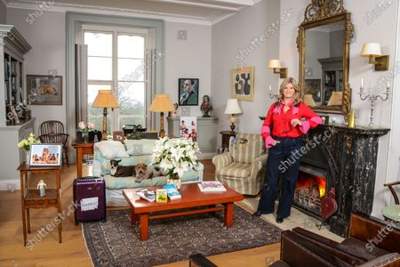 Susannah Constantine 'My Haven' Sitting room of her Sussex Home 5.12.2019 NIBBY award, Finger puppet, Painting of my dog, Signet ring,Family Photo, Daughters running medals, Painting of husband Sten Bertelsen Books- by Elton John, Ernest Hemingway & Susannah's own, Photo with Trinny (nude), Case (present from Trinny) with 'Strickley Come Dancing' sticker, Her Dogs Glasses