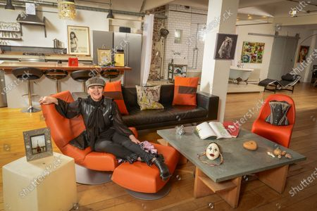 Frances Barber 'My Haven'-Living area of her London Loft Apartment 11.1.2020 Painting of my bull dog given to me by Ian McKellen  Corset I wore in Camille designed by Maria Bjornsen  Honorary Fellowships from universities  Original script of Sammy & Rosie Get Laid by Hanif kureishi  Mother's ring; handbag given to me by PSB opening of Closer To Heaven  Photos of me & my mum in Paris Wooden valentines heart hand carved. Theatre mask Handbag from The Pet Shop Boys Poster from the show Shells from trips