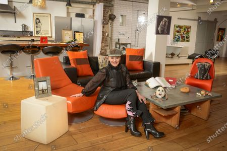 Stock Image of Frances Barber 'My Haven'-Living area of her London Loft Apartment 11.1.2020 Painting of my bull dog given to me by Ian McKellen  Corset I wore in Camille designed by Maria Bjornsen  Honorary Fellowships from universities  Original script of Sammy & Rosie Get Laid by Hanif kureishi  Mother's ring; handbag given to me by PSB opening of Closer To Heaven  Photos of me & my mum in Paris Wooden valentines heart hand carved. Theatre mask Handbag from The Pet Shop Boys Poster from the show Shells from trips