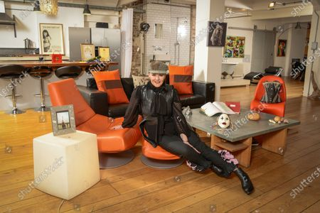 Stock Photo of Frances Barber 'My Haven'-Living area of her London Loft Apartment 11.1.2020 Painting of my bull dog given to me by Ian McKellen  Corset I wore in Camille designed by Maria Bjornsen  Honorary Fellowships from universities  Original script of Sammy & Rosie Get Laid by Hanif kureishi  Mother's ring; handbag given to me by PSB opening of Closer To Heaven  Photos of me & my mum in Paris Wooden valentines heart hand carved. Theatre mask Handbag from The Pet Shop Boys Poster from the show Shells from trips