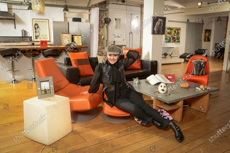 Stock Picture of Frances Barber 'My Haven'-Living area of her London Loft Apartment 11.1.2020 Painting of my bull dog given to me by Ian McKellen  Corset I wore in Camille designed by Maria Bjornsen  Honorary Fellowships from universities  Original script of Sammy & Rosie Get Laid by Hanif kureishi  Mother's ring; handbag given to me by PSB opening of Closer To Heaven  Photos of me & my mum in Paris Wooden valentines heart hand carved. Theatre mask Handbag from The Pet Shop Boys Poster from the show Shells from trips