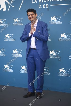 Director Chaitanya Tamhane poses for photographers at the photo call for the film 'The Disciple' during the 77th edition of the Venice Film Festival in Venice, Italy