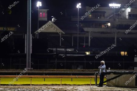 Trainer Bob Baffert watches at horses workout at Churchill Downs, in Louisville, Ky. The Kentucky Derby is scheduled for Saturday, Sept. 5th