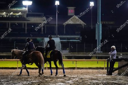 Trainer Bob Baffert watches as Kentucky Derby entry Thousand Words walks onto the track during a workout at Churchill Downs, in Louisville, Ky. The Kentucky Derby is scheduled for Saturday, Sept. 5th