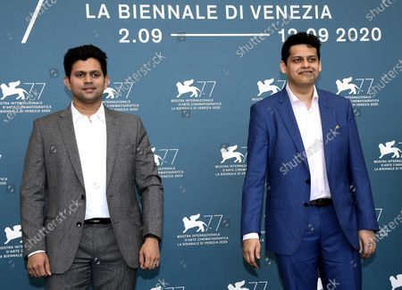 Chaitanya Tamhane (R) and Indian actor Aditya Modak (L) attend a photocall for 'The Disciple' at the 77th annual Venice International Film Festival, in Venice, Italy, 04 September 2020. The event is the first major in-person film fest to be held in the wake of the Covid-19 coronavirus pandemic. Attendees have to follow strict safety measures like mandatory face masks indoors, temperature scanners, and socially distanced screenings to reduce the risk of infection. The public is barred from the red carpet, and big stars are expected to be largely absent this year. The 77th edition of the festival runs from 02 to 12 September 2020.