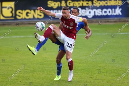 Matt Warburton of Northampton Town under pressure from Curtis Nelson of Cardiff City; PTS Academy Stadium, Northampton, East Midlands, England; English Football League Cup, Carabao Cup, Northampton Town versus Cardiff City.