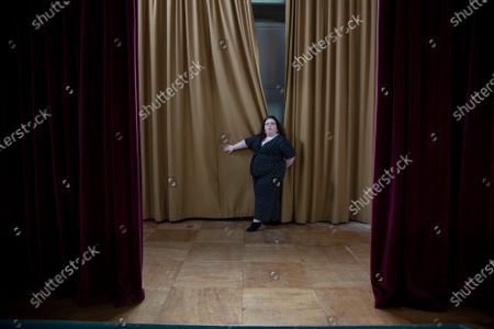 Portrait of Alison Spittle, Irish Comedian living in London. Photographed on a stage in a community hall.