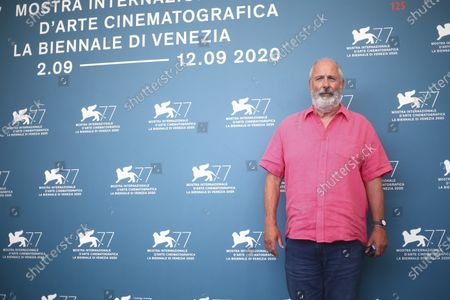 Director Roger Michell poses for photographers at the photo call for the film 'The Duke' during the 77th edition of the Venice Film Festival in Venice, Italy