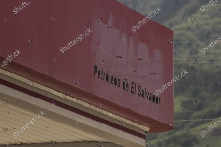 The remnants of a ALBA Petroleos sign is visible on the roof of a gas station in San Salvador, El Salvador