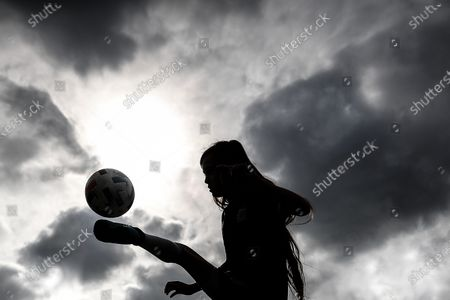 Argentina's Zoe Puente is silhouetted against the cloudy sky as she trains during an interview in Buenos Aires, Argentina, 03 September 2020 (issued 04 September 2020). At the age of just ten years, Zoe Puente, a young soccer player who is a fan of US player Alexandra Morgan of the Orlando Pride, and who herself plays in Platense and at the Roma Training Center, revolutionized Argentina with her videos of goals and dribbles and by devising a solidarity campaign with which she gathered around 500 boots and slippers so that 'everyone can play.'