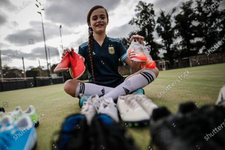 Argentina's Zoe Puente poses with sport slippers and soccer boots during an interview in Buenos Aires, Argentina, 03 September 2020 (issued 04 September 2020). At the age of just ten years, Zoe Puente, a young soccer player who is a fan of US player Alexandra Morgan of the Orlando Pride, and who herself plays in Platense and at the Roma Training Center, revolutionized Argentina with her videos of goals and dribbles and by devising a solidarity campaign with which she gathered around 500 boots and slippers so that 'everyone can play.'